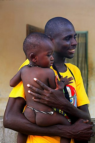 Man with child, M'Bour, Republic of Senegal, Africa