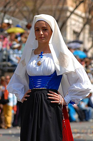 Woman in traditional dress, Cagliari, Sant'Efisio traditional event, the most important religious feast in Sardinia, Italy