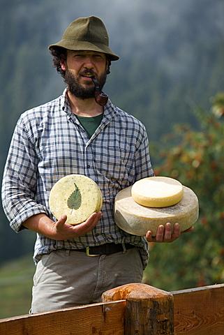 Agostino Manuel Cravos, milk processing, pasture Arnv=, Breguzzo valley, Giudicarie valley, Adamello Brenta Park, Trentino, Italy