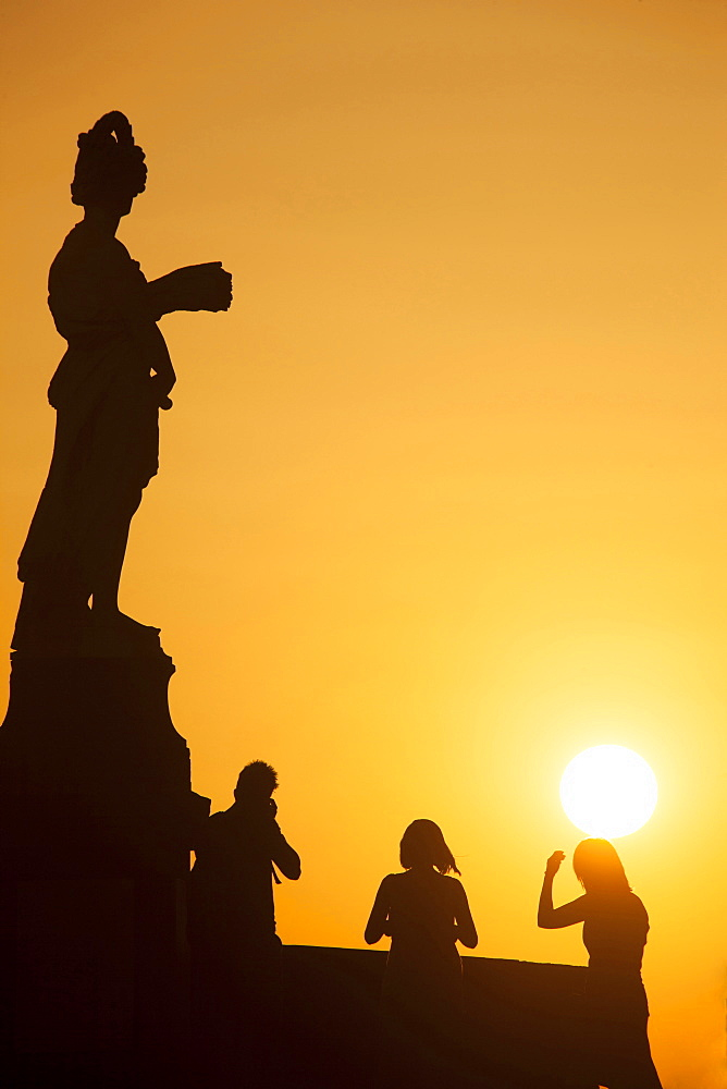 Statue on S.Trinita Bridge at sunset, Florence, Tuscany, Italy, Europe