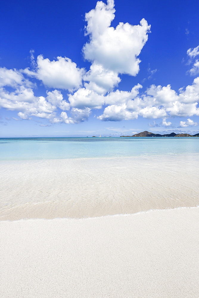 Blue sky frames the white sand and the turquoise Caribbean Sea, Ffryers Beach, Antigua and Barbuda, Leeward Islands, West Indies