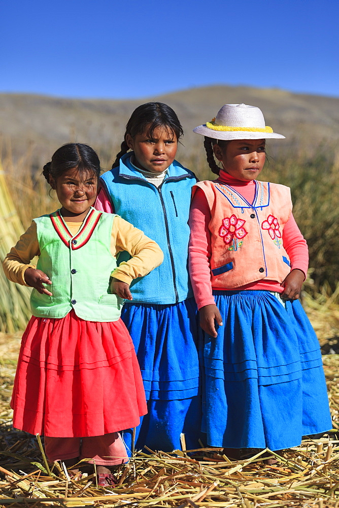 Children leaving on the Uros floating islands on Lake Titicaca, Puno, Peru
