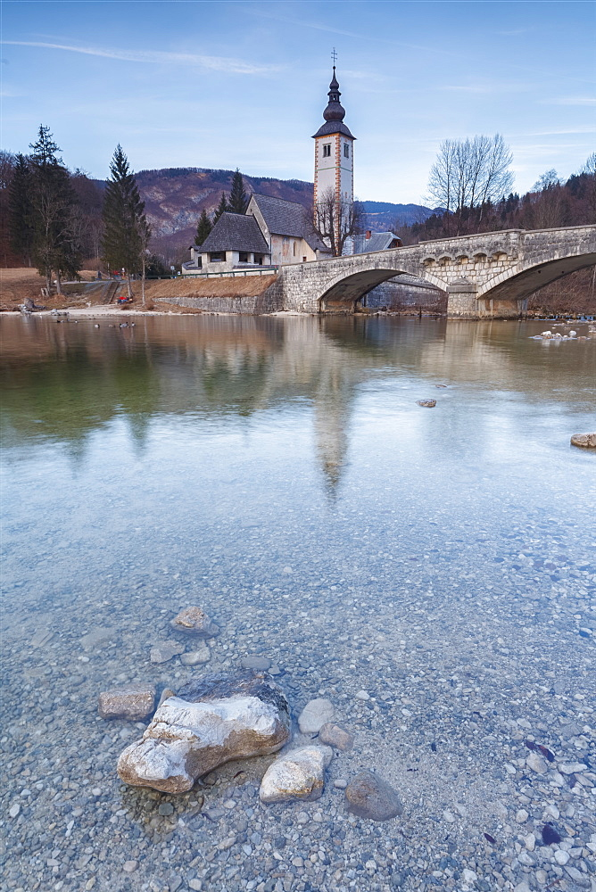 Church of Sv. John the Baptist and the stone bridge by the Bohinj lake, Upper Carniola, Slovenia, Europe