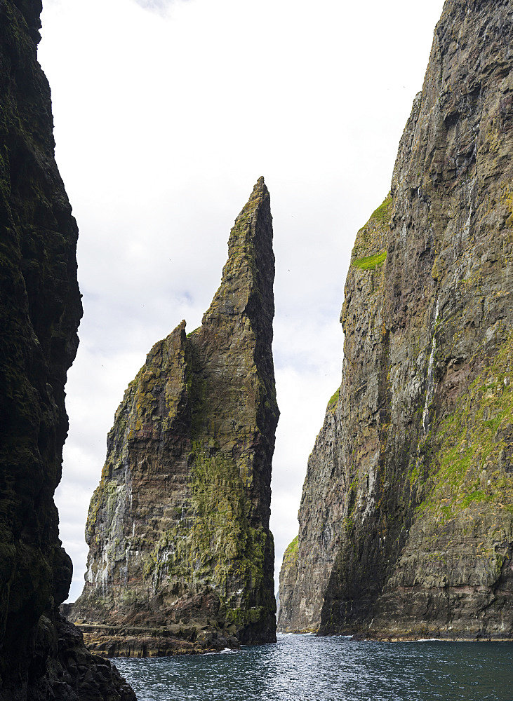 The cliffs, sea stacks and arches at Vestmanna, one of the big attractions of the Faroe Islands  The island Streymoy, one of the two large islands of the Faroe Islands  in the North Atlantic.  Europe, Northern Europe, Denmark, Faroe Islands