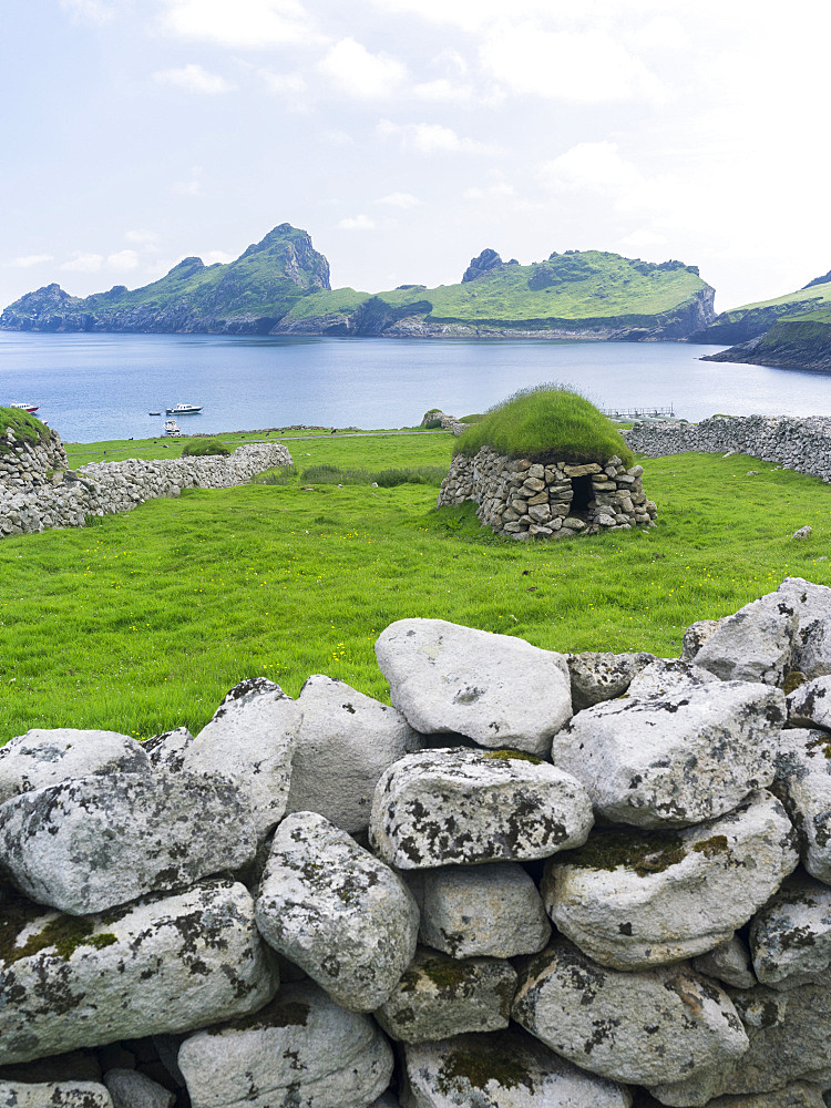 The islands of St Kilda archipelago in Scotland. Island of Hirta , Traditonal Cleit, a dry stone bothy used for storing food and other materials. It is one of the few places worldwide to hold joint UNESCO world heritage status for its natural and cultural qualities. Europe, Scotland, St. Kilda, July