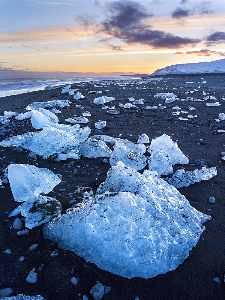 Iceberg on black vulcanic beach. North Atlantic beach of the ice lagoon Joekulsarlon at glacier Breithamerkurjoekull, Vatnajoekull NP. europe, northern europe, iceland, march