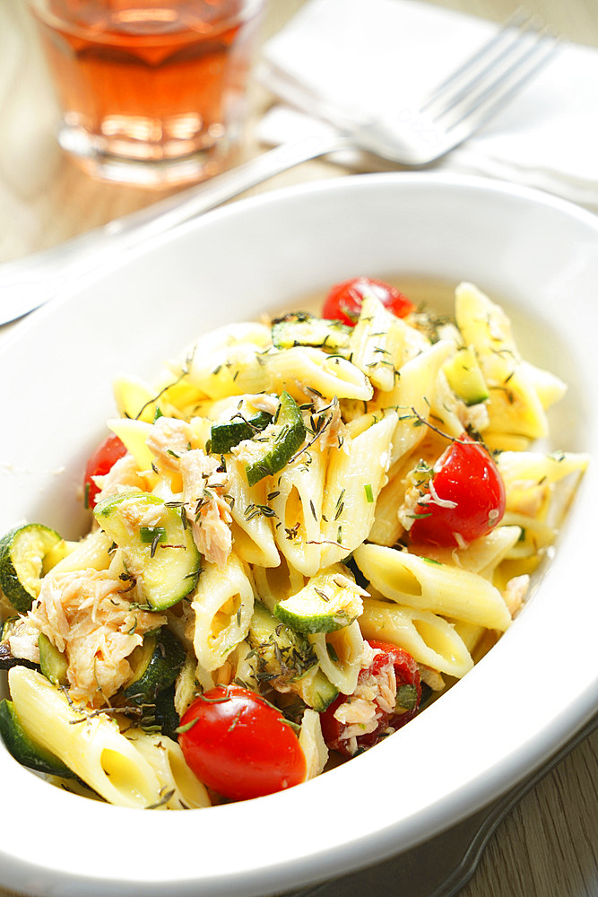 Pennette cold pasta with salmon, zucchini, cherry tomatoes and thyme