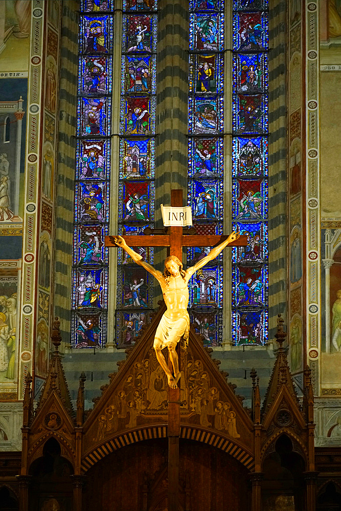 The Cathedral Basilica of Santa Maria Assunta is the main Catholic place of worship in Orvieto, and a masterpiece of Gothic architecture in Central Italy, wooden crucifix which is placed in the center of the chapel, behind the altar, is the work of Lorenzo Maitani, Umbria, Italy, Europe