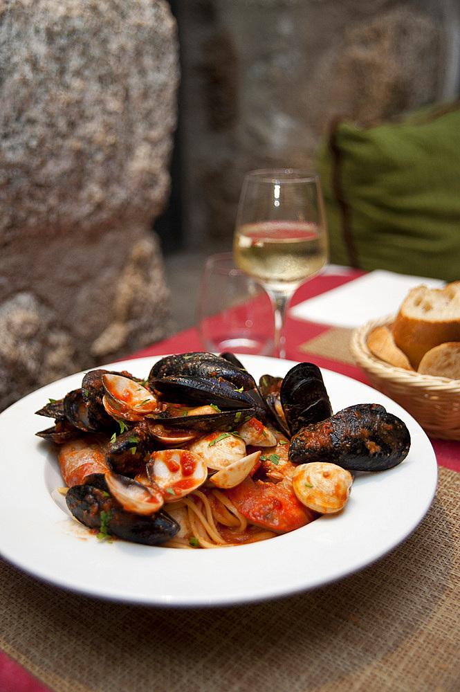 Spaghetti pasta with seafood and tomato sauce, Restaurant Terranova, Propriano, Corsica, France, Europe