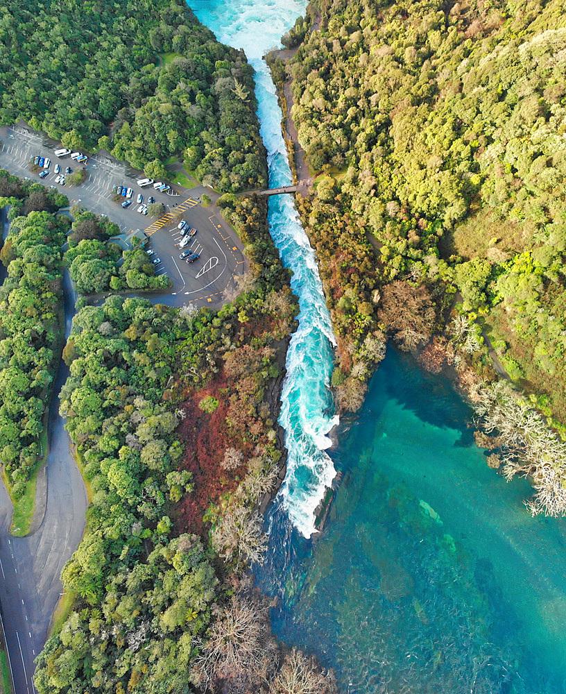 Huka Falls, New Zealand. Panoramic aerial view of beautiful waterfalls and countryside at sunset.