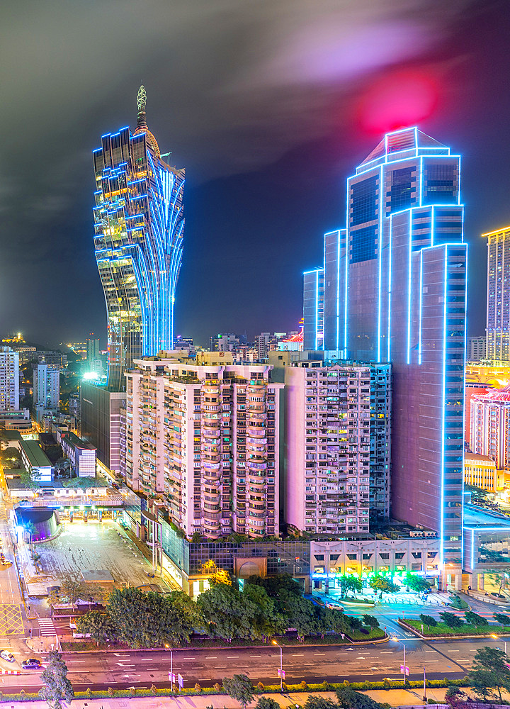 Casinos and skyscrapers of Macau at night. City modern skyline.
