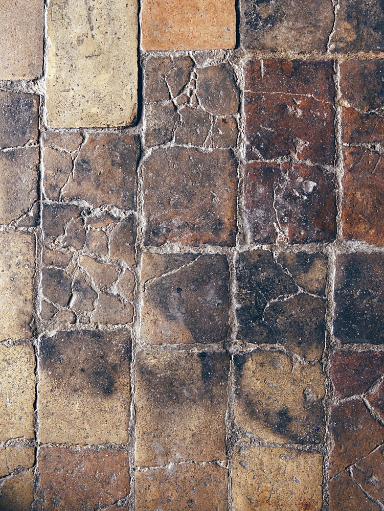 "Detail of the ancient pavement inside one of the rooms of the hotel Le Grotte della Civita, it is a hotel housed in ancient cave houses by the projects of ""Sextantio"" Matera, Basilicata, Italy, Europe"