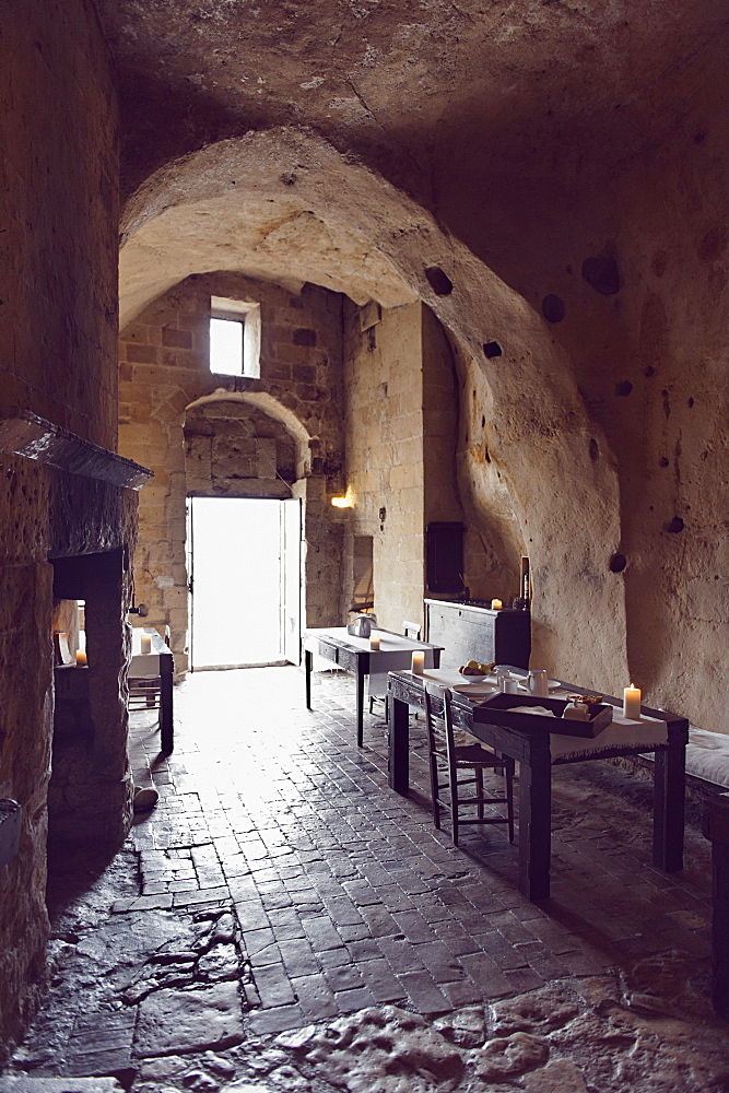 "Dining rooms of the hotel Le Grotte della Civita, It is a hotel housed in ancient cave houses by the projects of ""Sextantio"", Matera, Basilicata, Italy, Europe"