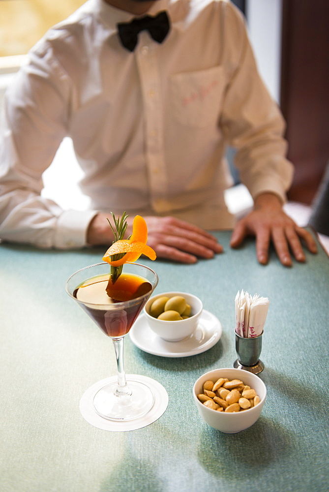 Still life of Zazou cocktail with olives and almonds at Bar Luce, Fondazione Prada, Milano, Lombardy, Italy, Europe