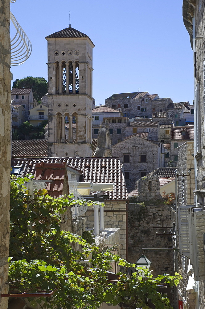 Rooftop view over the roofs to the bell tower of St. Stephens Cathedral in the medieval city of Hvar, island of Hvar, Dalmatia, Croatia, Europe