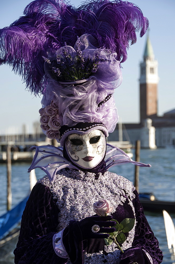 Lady in black and purple mask and feathered hat, Venice Carnival, Venice, UNESCO World Heritage Site, Veneto, Italy, Europe
