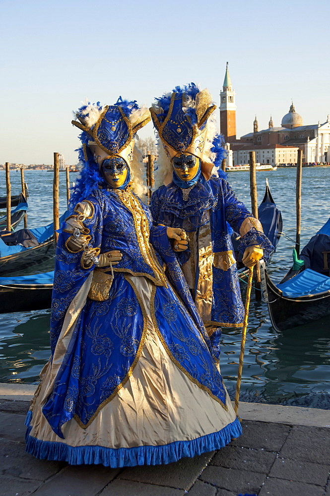 Two ladies in blue and gold masks, Venice Carnival, Venice, UNESCO World Heritage Site, Veneto, Italy, Europe