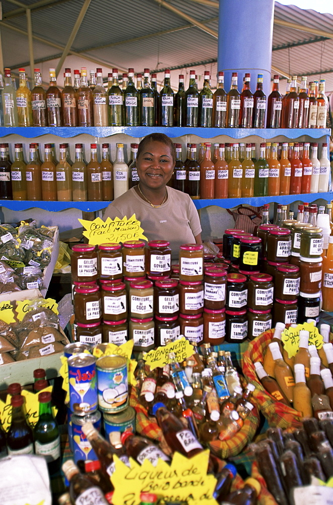Woman selling locally produced food at the market in Sainte Anne, Martinique, Lesser Antilles, West Indies, Caribbean, Central America