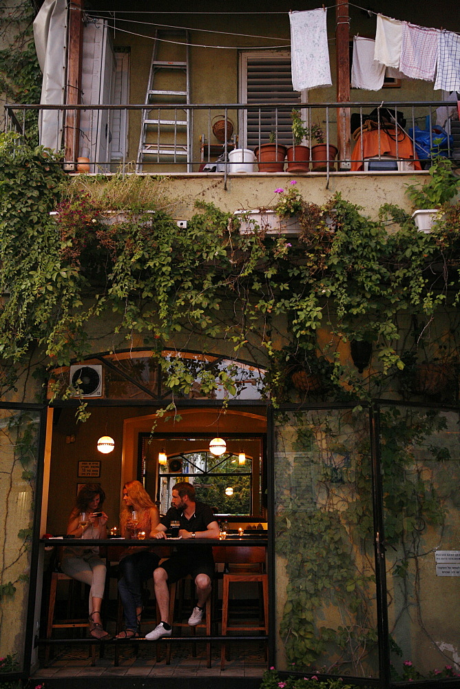 People sitting at a bar in the trendy Neve Tzedek neighbourhood, Tel Aviv, Israel, Middle East