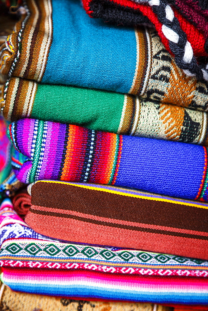 Colorful carpets made of llama and alpaca wool for sale at San Pedro market, Cuzco, Peru.