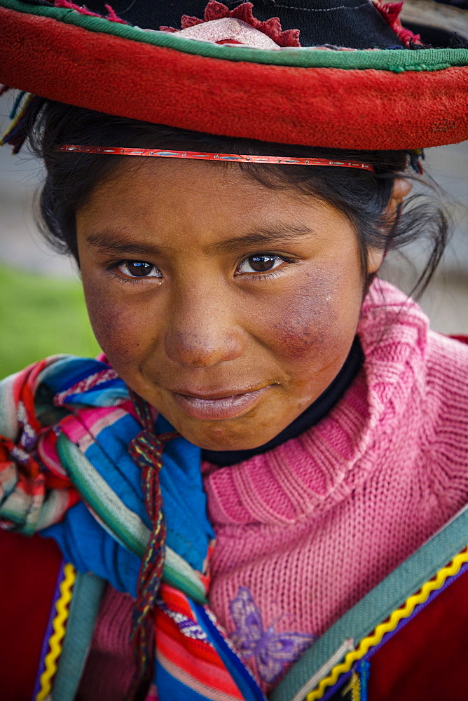 Portrait of a Quechua girl with traditional dress, Cuzco, Peru, South America