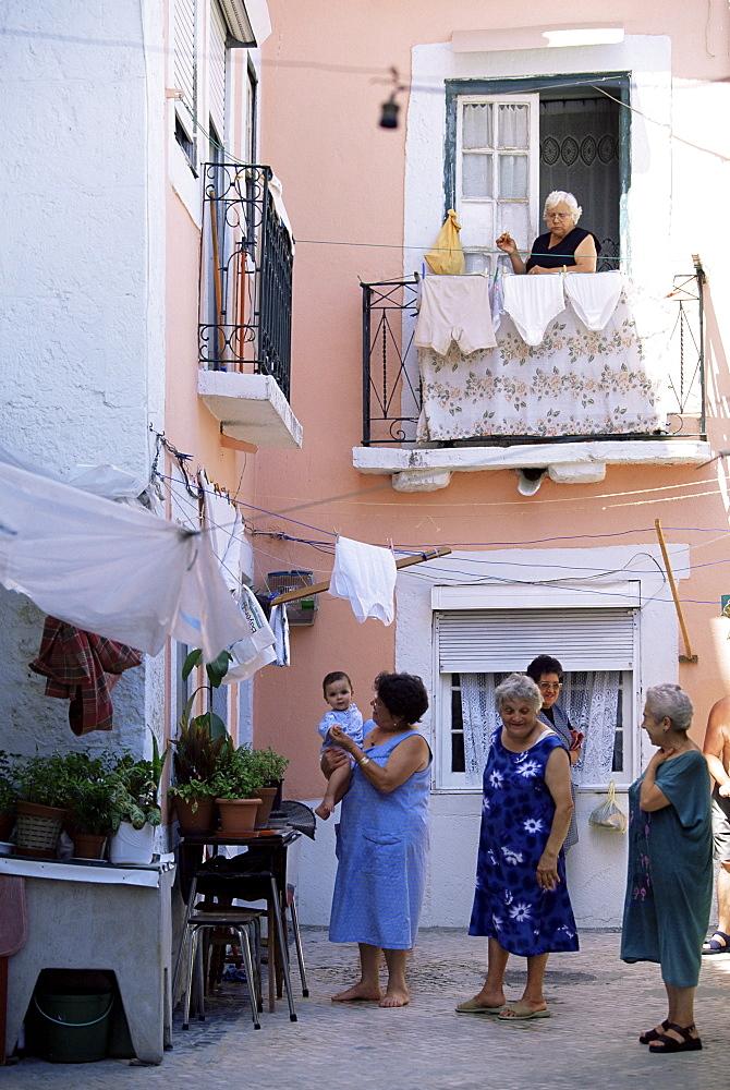 Women in the Moorish quarter of Alfama, Lisbon, Portugal, Europe