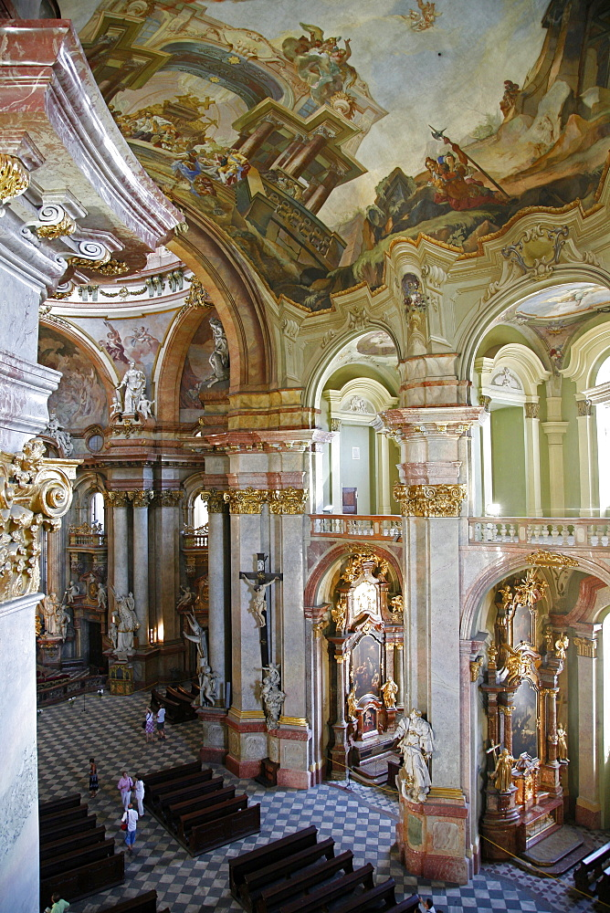 The Baroque interior of St. Nicholas Church in Mala Strana, Prague, Czech Republic, Europe