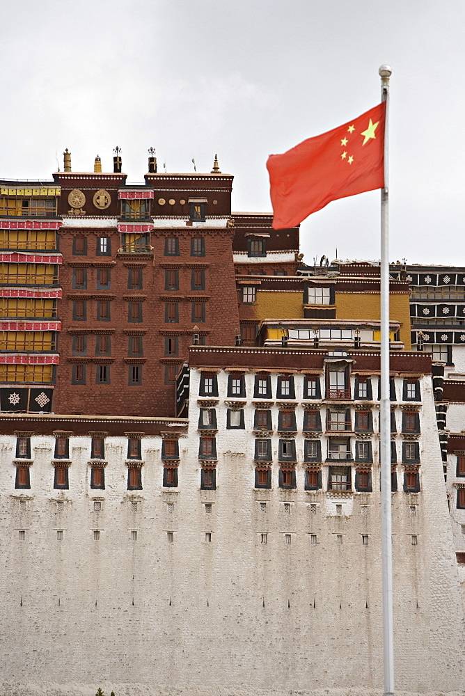 The red flag of China flies in front of the Potala Palace, UNESCO World Heritage Site, Lhasa, Tibet, China, Asia