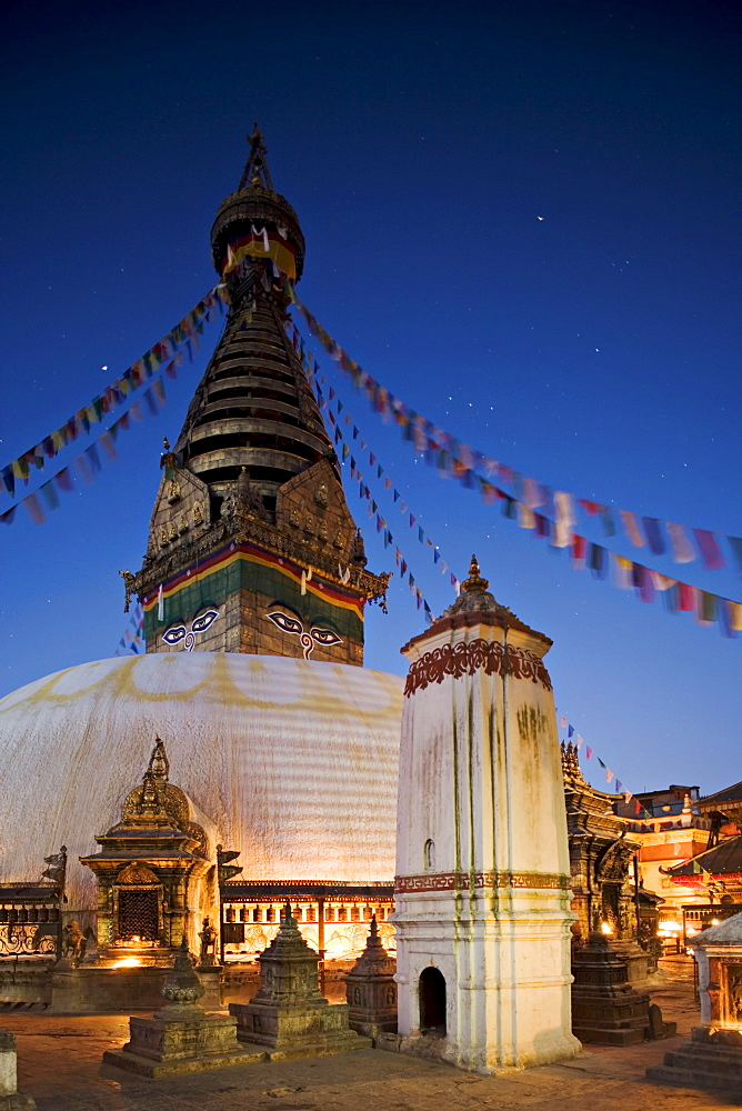 Swayambhunath (Swayambhu) (Monkey Temple) Buddhist stupa on a hill overlooking Kathmandu, taken at dawn with Orion in the sky behind the prayer flags, Kathmandu, UNESCO World Heritage Site, Nepal, Asia