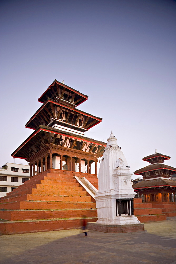 Maju Deval triple roofed Hindu temple with shikara-style Buddhist stupa in front and Narayan temple on far right at dawn, Durbar Square, Kathmandu, UNESCO World Heritage Site, Nepal, Asia