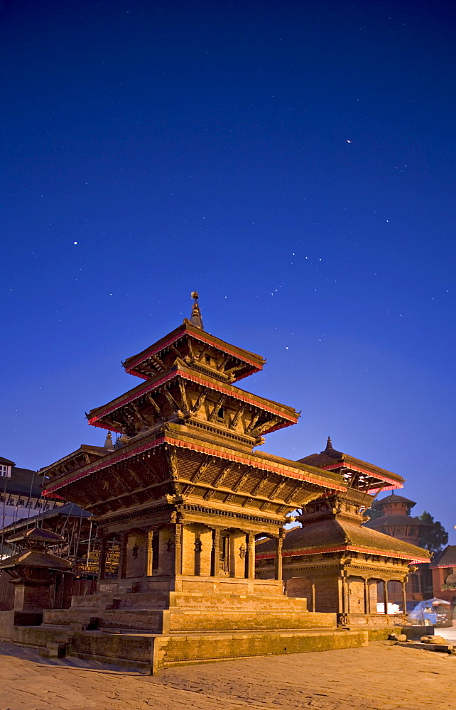 Orion in sky at dawn above triple roofed pagoda temple in foreground and Indrapur temple to the right, Durbar Square, Kathmandu, UNESCO World Heritage Site, Nepal, Asia