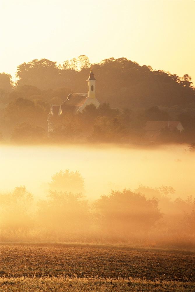 Grafrath Monastery in fog, at sunrise, Bavaria, Germany, Europe