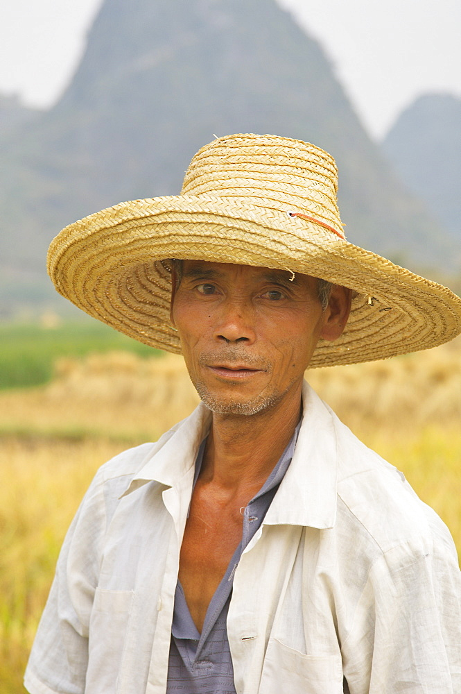 Portrait of Chinese rice farmer, Yulong River valley, Yangshuo, Guangxi Province, China, Asia - 756-29