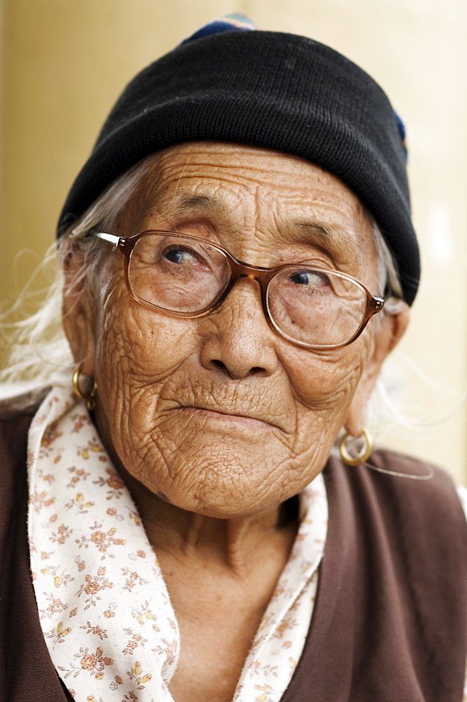 Portrait of a Tibetan woman, McLeod Ganj, Dharamsala, Himachal Pradesh state, India, Asia - 756-599