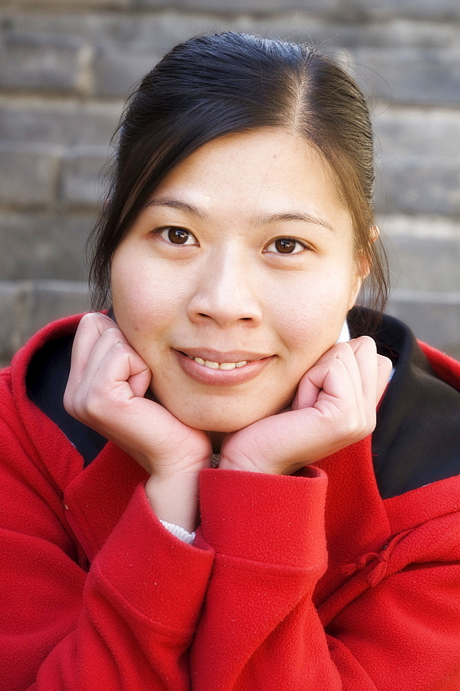 Portrait of a young Chinese woman at the Great Wall, Badaling, China, Asia