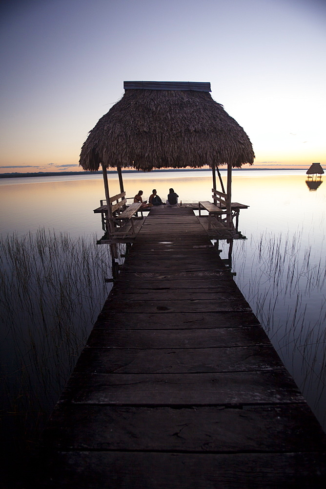 People relaxing at sunset, Lago Peten Itza, El Remate, Guatemala, Central America - 757-240