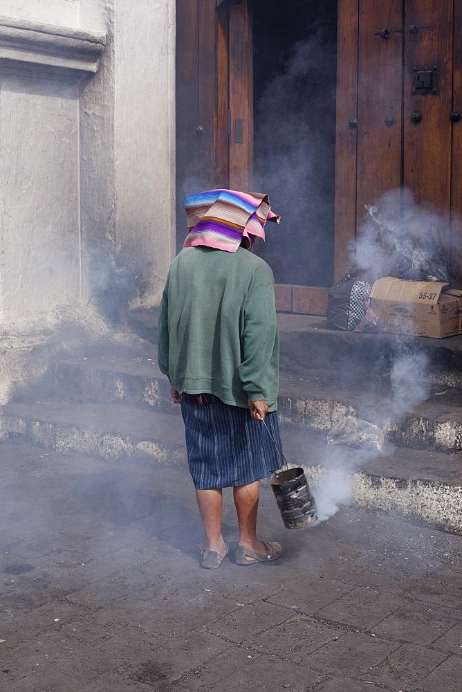 Mayan woman performing ritual, Chichicastenango, Guatemala, Central America - 757-253