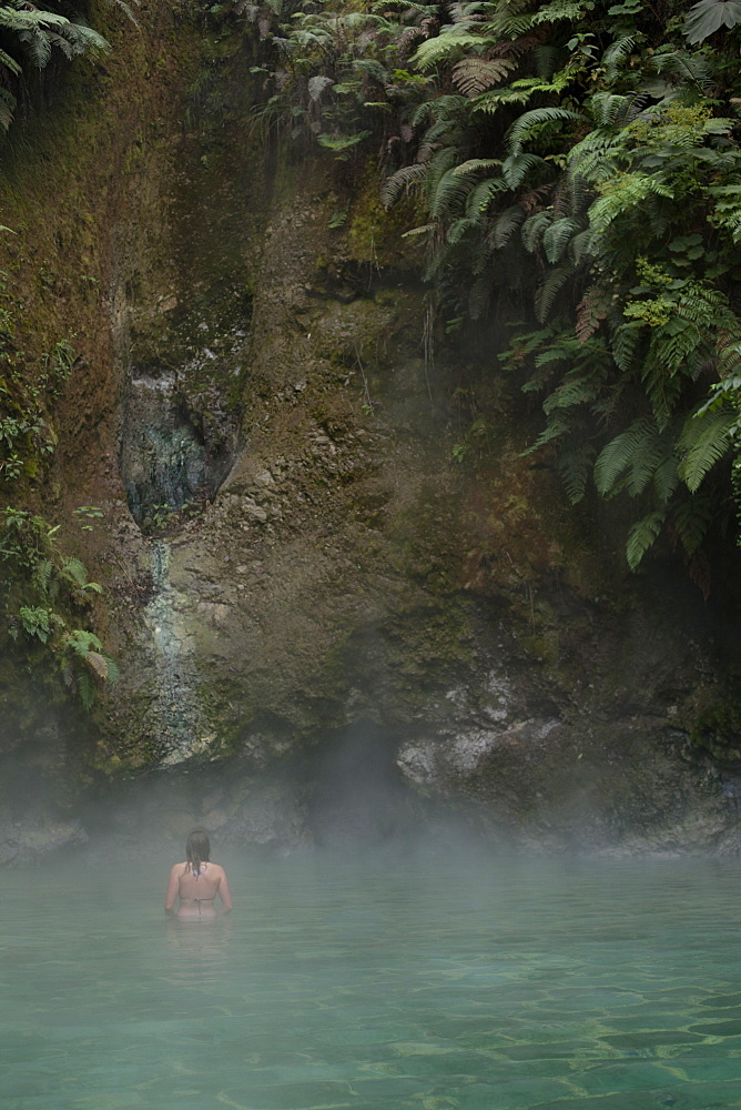 Woman in hot springs, Las Fuentes Gorginas, Zunil, Quetzaltenango, Guatemala, Central America