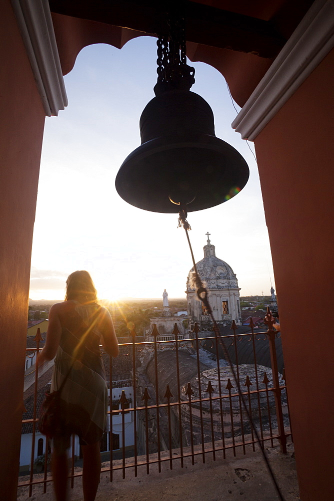 Woman takes in view from the Merced bell tower in Granada, Nicaragua, Central America