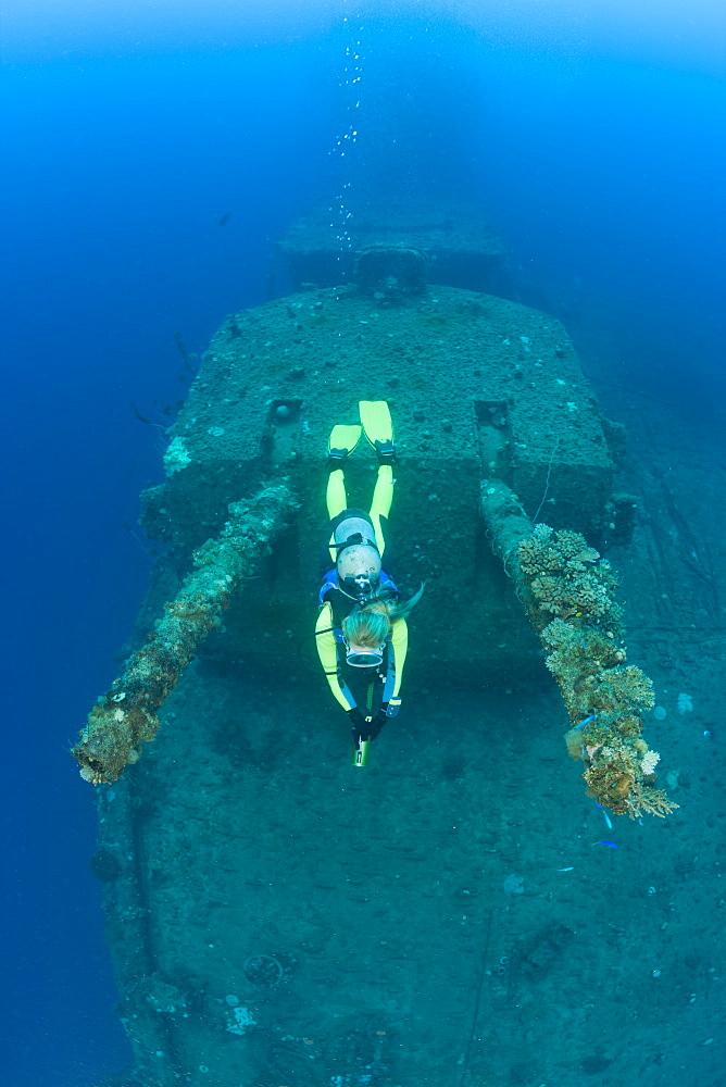 Diver and Twin 8-inch 55 caliber Gun on USS Saratoga, Marshall Islands, Bikini Atoll, Micronesia, Pacific Ocean