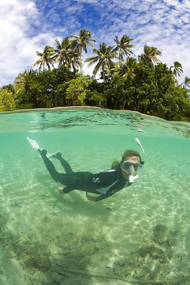 Snorkeling in Lagoon of Ahe Island, Cenderawasih Bay, West Papua, Indonesia, Southeast Asia, Asia