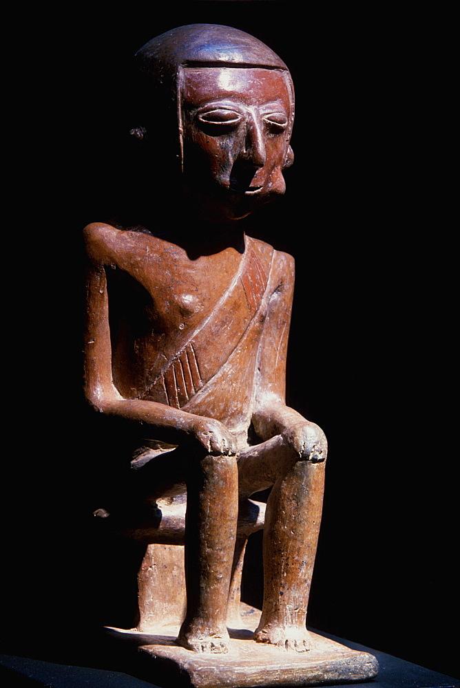 Carchi Culture a 'Coquero' ceramic funerary figure chewing coca, in the collection of the Banco Central de Ecuador, Quito, North Coast, Ecuador