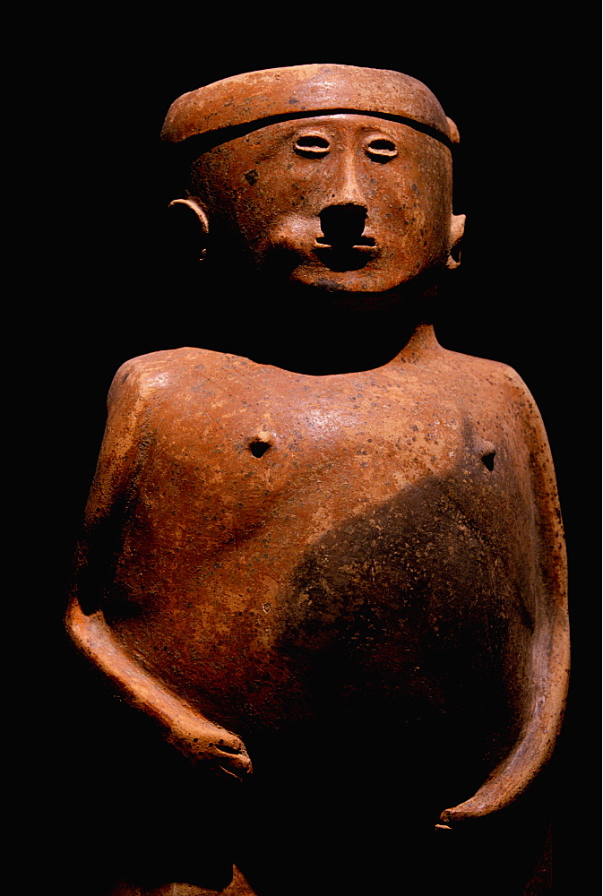 Capuli Culture a ceramic 'Coquero' funerary figure chewing coca, from the collection of the Banco Central de Ecuador, Quito, Ecuador