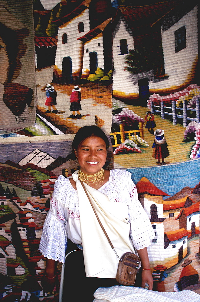 Otavalo, north of Quito is one of Latin Am's most famous markets for textiles, crafts and produce Otavalo woman selling textiles, Quito, Ecuador