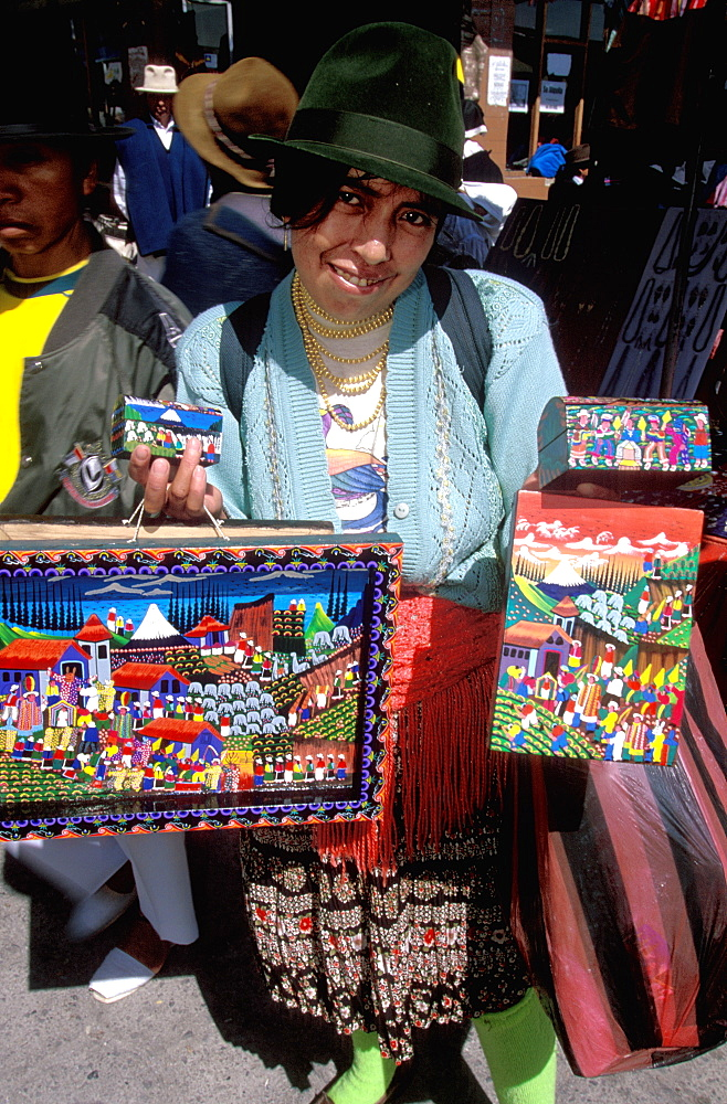 Otavalo, north of Quito is one of Latin Am's most famous markets for textiles, crafts and produce paintings of village scenes & life, Quito, Ecuador