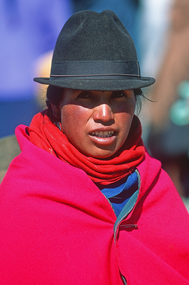 Saquisili south of Quito is one of Latin America's most important indigenous markets woman in brightly colored traditional dress, Quito, Ecuador
