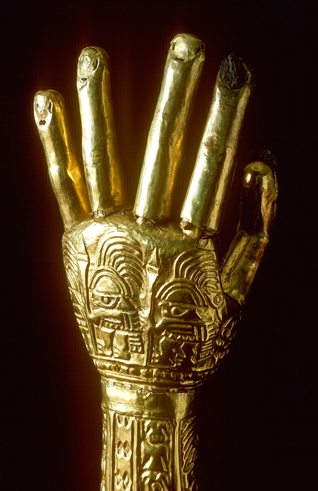 Precolumbian Gold Chimu Culture 1000-1400AD Gold Arms with embossed warrior figures, used in funerary rites collection of Museo del Oro, Lima, Peru