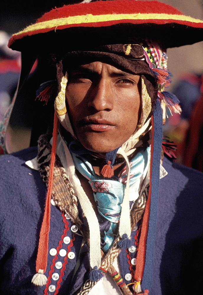 Inti Raymi spectator in traditional dress during the Incan Festival of the Sun, held at Sacsayhuaman, above Cuzco on June 24th, Peru