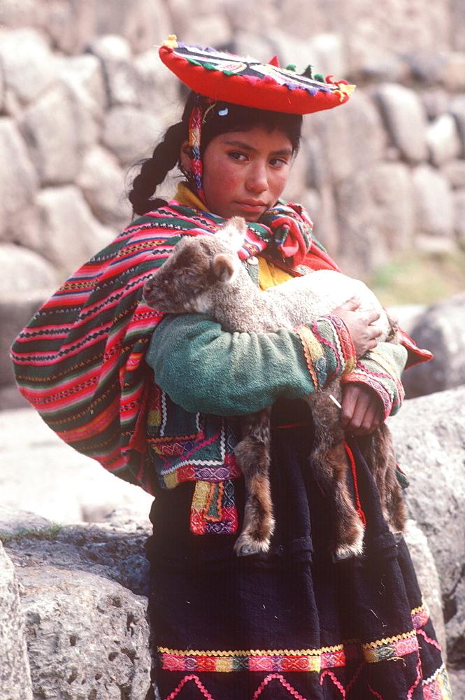 A young Quechua girl and her lamb at Tambo Machay, the ancient Incan Royal Baths near Cuzco, Peru - 763-947