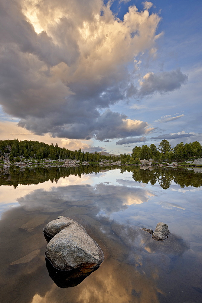 Cloud at sunset reflected in an unnamed lake, Shoshone National Forest, Wyoming, United States of America, North America